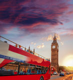 Big Ben with double decker bus against sunset in London, England, UK Royalty Free Stock Photography