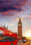 Big Ben with double decker bus against sunset in London, England, UK Stock Images