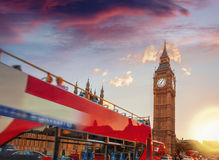 Big Ben with double decker bus against sunset in London, England, UK Stock Photography