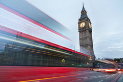 Big Ben in the early morning and red bus passing in London Royalty Free Stock Image