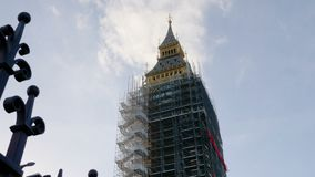 Big Ben Elizabeth Tower restoration surrounded by scaffolding during conservation refurbishment. London, UK, 4k. Big Ben Elizabeth Tower restoration surrounded stock video
