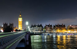 Big Ben, English parliament and Westminster Bridge view at night Stock Photos