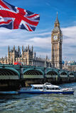 Big Ben with flag of United Kingdom in London, UK Stock Photography