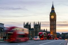 The Big Ben, House of Parliament and double-decker bus blurred i. N motion, London, UK Royalty Free Stock Photos