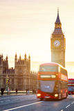 The Big Ben, House of Parliament and double-decker bus blurred i Stock Image