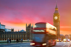 The Big Ben, House of Parliament and double-decker bus blurred i. N motion, London, UK Royalty Free Stock Image