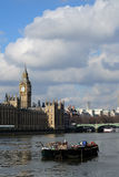 Big Ben & Houses Parliament. Big Ben, House of Lords and commons with Westminster Bridge looking across a river Thames barge boat Royalty Free Stock Images