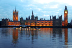 Big Ben and Houses of Parliament. Evening Big Ben and Houses of Parliamen with moving ship on the Thames, London, UK Stock Image