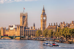 Big Ben and Houses of Parliament with boat in London, England, UK. Famous Big Ben and Houses of Parliament with boat in London, England, UK Royalty Free Stock Photo