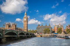 Big Ben and Houses of Parliament with boat in London, England, UK royalty free stock images