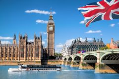 Big Ben and Houses of Parliament with boat in London, UK Stock Photos