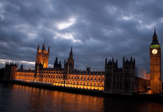 The Big Ben and the Houses of Parliament at dusk. With a cloudy sky Stock Photos