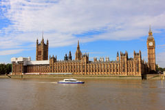 Big ben, houses of parliament and ferry in london Royalty Free Stock Image