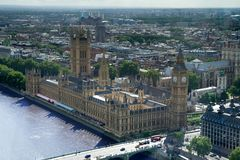 Big Ben and the Houses of Parliament, London. Aerial view including Westminster Palace, Westminster Abbey and Battersea Powerstation royalty free stock photography