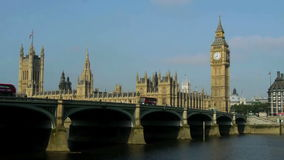Big ben and houses of parliament in london, over the river thames stock video