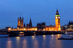 Big Ben and Houses of Parliament  at night. Westminster Palace in London reflected in River Thames at night Royalty Free Stock Photo