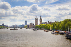 Big Ben and Houses of Parliament on Thames river Stock Images