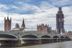Big Ben, the iconic landmark of London, and the Palace of Westminster being scaffolded during the significant renovation. London, UK - April 2018: The Elizabeth Royalty Free Stock Photos