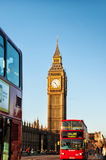 Big Ben and iconic red buses in London, UK Stock Photo