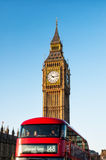 Big Ben and iconic red buses in London, UK Royalty Free Stock Images
