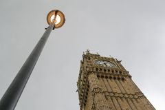 Big Ben with a lamp in London. Stock Images