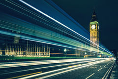 Big Ben and lights of the cars passing by Stock Photos