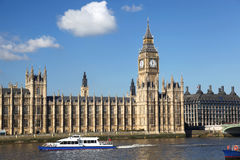 Big Ben in London, England. Big Ben with motor boat in London, England Stock Image