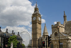 The Big Ben and London Eye. View of the Big Ben with the London Eye in the background Stock Image