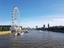 London Eye and Big Ben from Charing Cross Bridge over The Thames  Royalty Free Stock Photo