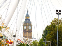 Big Ben through the London Eye England UK Stock Image