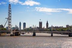 Big Ben and London eye. LONDON, UK - 22 JULY, 2014: Centre of London view from the London bridge. Big Ben and London eye Royalty Free Stock Photos