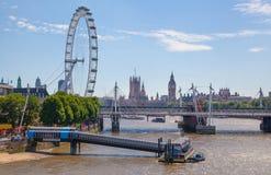Big Ben and London eye. LONDON, UK - 22 JULY, 2014: Centre of London view from the London bridge. Big Ben and London eye Stock Photo