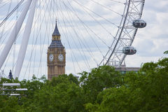 Big Ben with London Eye. LONDON, UK - JUNE 15: Big Ben framed by London Eye cables, with two of the structure's capsules in the frame. June 15, 2015 in London Royalty Free Stock Photo