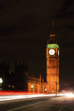 Big Ben London at night. Big Ben and London at night with the lights of the cars passing by, the most prominent symbols of both London and England Royalty Free Stock Photos