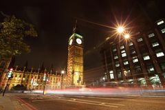 Big Ben London at night. Big Ben and London at night with the lights of the cars passing by, the most prominent symbols of both London and England Royalty Free Stock Images