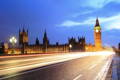 Big Ben London at night. Big Ben and London at night with the lights of the cars passing by after rain, the most prominent symbols of both London and England Royalty Free Stock Photos