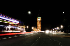 Big Ben in London at Night. Time Lapse Street View Stock Photo