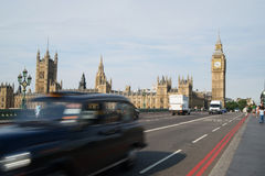 Big Ben and London taxi. In motion blur Royalty Free Stock Photo