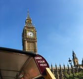Big Ben with London tour bus. Tour bus in front of Big Ben tower on Parliament Building in London, England Stock Photos