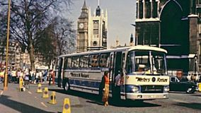 Big Ben London tourists. London, United Kingdom - Circa 1979: Tourists in vintage dress with touristic bus at Westminster Palace with Big Ben clock tower, Houses stock footage