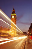 Big Ben, London, UK. Big Ben viewed from Westminster Bridge at night with traffic light trails Royalty Free Stock Images