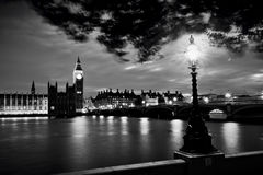 Big Ben, London the UK at sunset. Retro street lamp light on Westminster Bridge. Black and white Stock Images