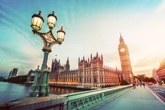 Big Ben, London the UK at sunset. Retro street lamp light on Westminster Bridge. Vintage Stock Photography