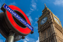 Big Ben and London Underground station sign. LONDON – AUGUST 7: Big Ben Clock and London Underground station sign on August 7, 2013. The London Underground is Stock Photography