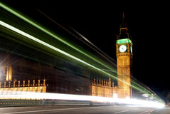 Big Ben at night. With light beams caused by passing cars Stock Image
