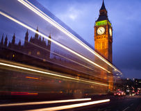 Big Ben At Night. A photo taken of the 'big ben' at night with the light trails from a london bus passing by Royalty Free Stock Photos