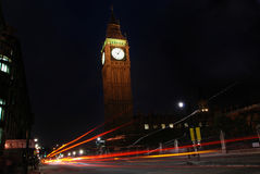 Big Ben at night. With light beams caused by passing cars Royalty Free Stock Photos