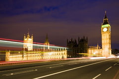 Big Ben at night. Nocturne scene with Big Ben behind light beams Royalty Free Stock Images