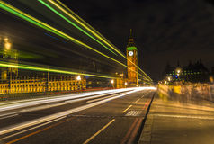 The Big Ben at night and light trails, London. UK Stock Images