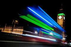Big Ben at night. With light trails of passing buses Royalty Free Stock Photos